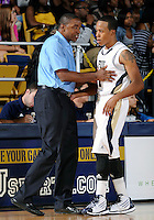 Florida International University Head Coach Isiah Thomas during the game against Florida Memorial University in an exhibition game .  FIU won the game 86-69 on November 9, 2011 at Miami, Florida. .