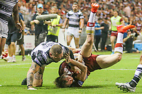 Picture by David Neilson/SWpix.com/PhotosportNZ - 10/02/2018 - Rugby League - Betfred Super League - Wigan Warriors v Hull FC  - WIN Stadium, Wollongong, Australia - Wigan's Dan Sarginson is brought down by Hull FC's Josh Griffin.