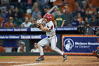 Robert Moore (1) of the Arkansas Razorbacks follows through on his swing against the Texas Longhorns in game six of the 2020 Shriners Hospitals for Children College Classic at Minute Maid Park on February 28, 2020 in Houston, Texas. The Longhorns defeated the Razorbacks 8-7. (Brian Westerholt/Four Seam Images)