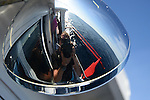 Apo Reef, Sulu Sea -- Self-portrait in the mirrored surface of a boat light.