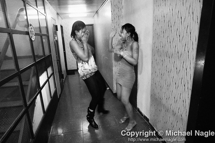 BROOKLYN  -  MARCH 08, 2009:  Jalisa Milner talks with her cousin at her 21st birthday with her friends at her apt in the Sheepshead Bay/Nostrand Houses housing project complex on March 7, 2009 in Brooklyn.  (PHOTOGRAPH BY MICHAEL NAGLE)