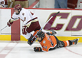 Anthony Aiello 2 of Boston College and Todd McIlrath 24 of Bowling Green collide in front of the BC penalty box.  The Eagles of Boston College defeated the Falcons of Bowling Green State University 5-1 on Saturday, October 21, 2006, at Kelley Rink of Conte Forum in Chestnut Hill, Massachusetts.<br />