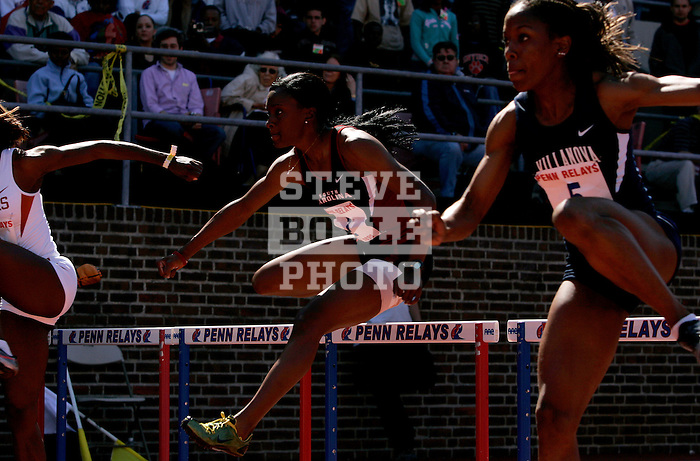 Athletes compete in the collegiate women's 100m hurdles championship race on Saturday, April 29, 2006 during the 112th running of the Penn Relays Carnival at Franklin Field in Philadelphia Pennsylvania...