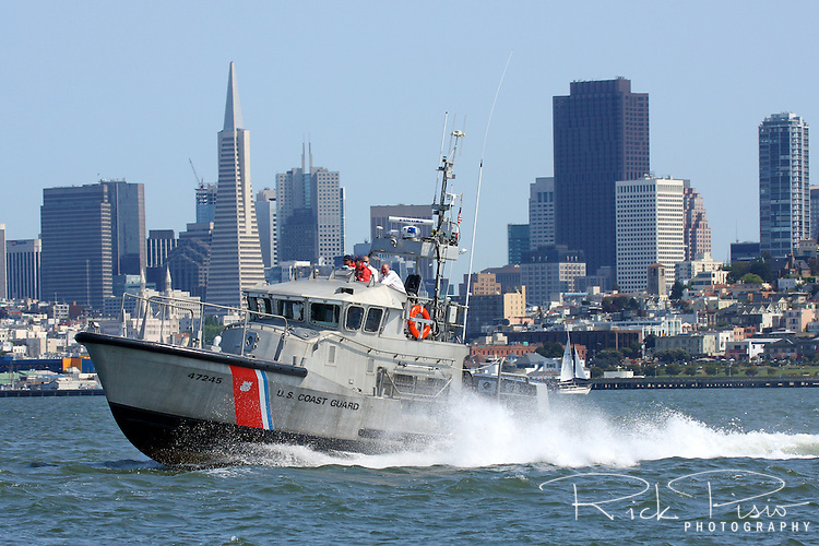 A United States Coast Guard 47 foot Motor Lifeboat based at Station Golden Gate searches the waters of San Francisco Bay for a PIW (Person In Water) after a report of a person jumping from the Golden Gate Bridge. Station Golden Gate operates 3 of the 47 foot MLB's and is responsible for the coastal and offshore water near the San Francisco Bay Area. The MLB is built to withstand the most severe conditions at sea and are self-bailing, self-righting, and almost unsinkable. Photographed 4/26/08