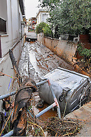 Pictured: Mud, debris and a refuse bin on the streets  in Messini, near the town of Kalamata, Messinia, Greece. Wednesday 07 September 2016<br /> Re: Severe flash flooding has affected parts of Messinia County in southern Greece.