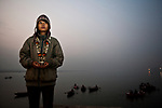 A young japanese tourist girl on the ghats in Varanasi at the break of dawn. Photograph © Santosh Verma