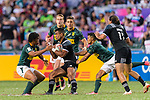 Jona Nareki of New Zealand (C) frights with Stedman Gans of South Africa (L) during the HSBC Hong Kong Sevens 2018 Bronze Medal Final match between South Africa and New Zealand on 08 April 2018 in Hong Kong, Hong Kong. Photo by Marcio Rodrigo Machado / Power Sport Images