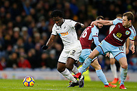 Wilfried Bony of Swansea City is tackled by Ashley Barnes of Burnley during the Premier League match between Burnley and Swansea City at Turf Moor, Burnley, England, UK. Saturday 18 November 2017