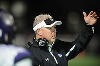 NWA Democrat-Gazette/ANDY SHUPE<br /> Fayetteville coach Daryl Patton speaks to his players against Springdale Friday, Oct. 9, 2015, during the first half of play at Jarrell Williams Bulldog Stadium in Springdale. Visit nwadg.com/photos to see more photographs from the game.