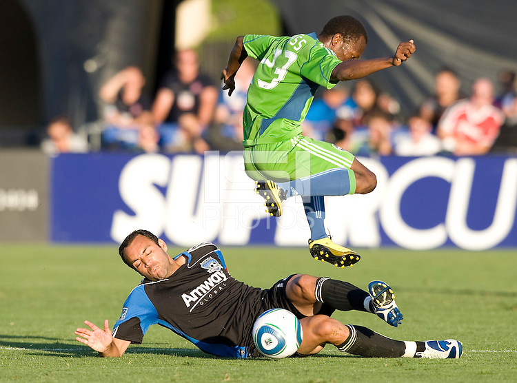 Sanna Nyassi of Sounders leaps over Ramiro Corrales of Earthquakes as Corrales tries to tackle the ball during the game at Buck Shaw Stadium in Santa Clara, California on July 31st, 2010.   Seattle Sounders defeated San Jose Earthquakes, 1-0.