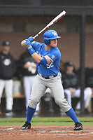 Center fielder Ben Aklinski (52) of the Kentucky Wildcats bats in a game in the rain against the University of South Carolina Upstate Spartans on Saturday, February 17, 2018, at Cleveland S. Harley Park in Spartanburg, South Carolina. Kentucky won, 6-5, in 10 innings. (Tom Priddy/Four Seam Images)