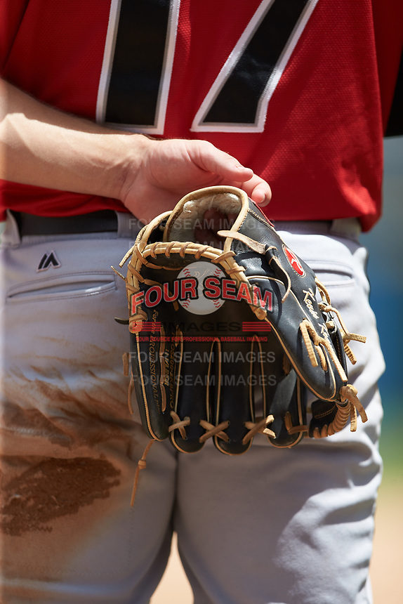 "Indianapolis Indians second baseman Kevin Kramer (17) holds his glove behind his back during the playing of ""God Bless America"" between innings of the game against the Charlotte Knights at BB&T BallPark on August 22, 2018 in Charlotte, North Carolina.  The Indians defeated the Knights 6-4 in 11 innings.  (Brian Westerholt/Four Seam Images)"