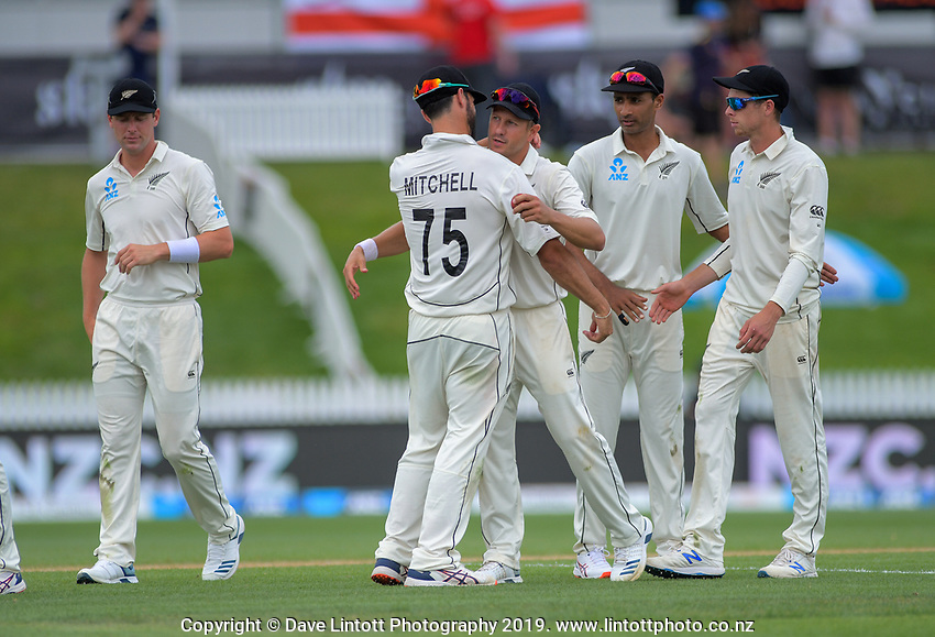 NZ's Daryl Mitchell congratulates NZ's Neil Wagner on his 5-wicket bag during day four of the international cricket 2nd test match between NZ Black Caps and England at Seddon Park in Hamilton, New Zealand on Friday, 22 November 2019. Photo: Dave Lintott / lintottphoto.co.nz
