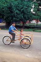 Man and his daughter riding a bicycle in San Cristobal de Las Casas, Chiapas, Mexico
