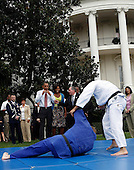 Washington, DC - September 16, 2009 -- United States President Barack Obama and his wife Michelle watch a demonstration of judo during an event on Olympics, Paralympics and Youth Sport Canadian on the South Lawn of the White House, Washington, DC, September 16, 2009. .They are supporting the candidacy of the city of Chicago as the city host for the Summer Olympic Games 2016..Credit: Aude Guerrucci / Pool via CNP