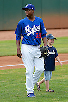 Ogden Raptors Victor Araujo #38 takes to the field with a young fan prior to the game against the Idaho Falls Chukars at Lindquist Field on June 23, 2013 in Ogden, Utah. (Stephen Smith/Four Seam Images)