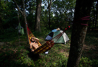 Matt Watts, 26, relaxes in his hammock on June 22, 2012, during the four-day Wild Goose Festival, held at the Shakori Hills Community Arts Center in Pittsboro, NC.