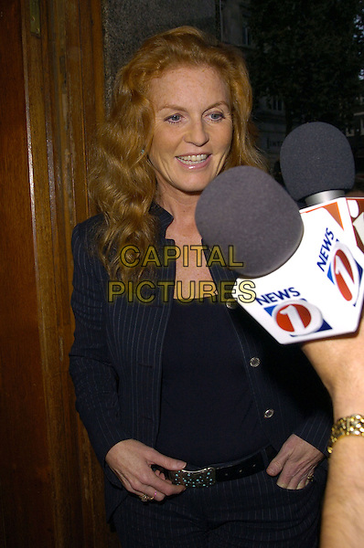 "SARAH FERGUSON, DUCHESS OF YORK.arrivals at book launch of ""Confessions of a Serial Womaniser"" by Zerbanoo Gifford, at the National Portrait Gallery.20th September London, England.half length fergie.CAP/CAN.©Can Nguyen/Capital Pictures"