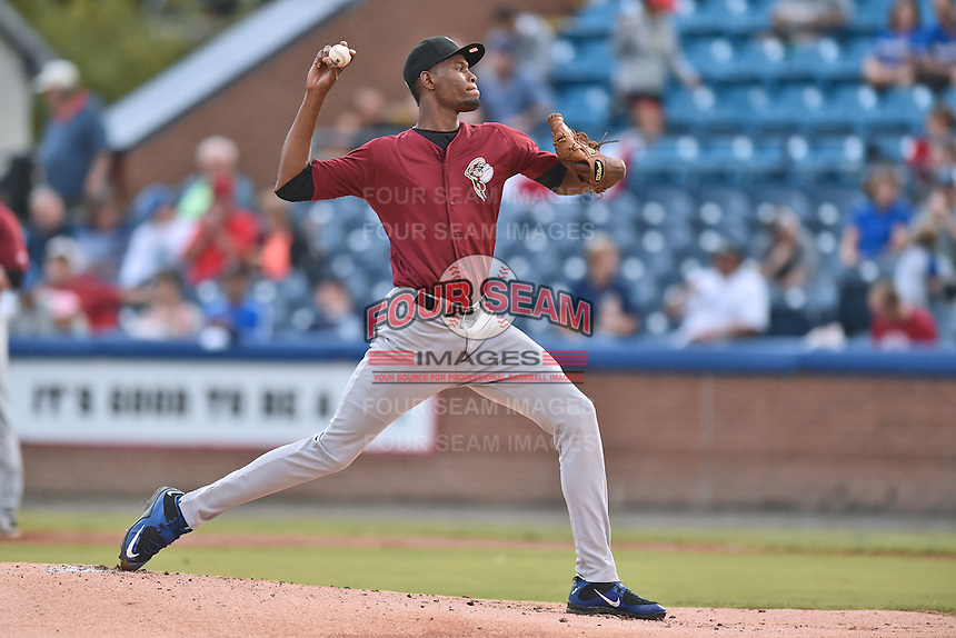 Savannah Sand Gnats starting pitcher Martires Arias (18) delivers a pitch during game one of the Southern Division South Atlantic League Playoffs against the Asheville Tourists on September 9, 2015 in Asheville, North Carolina. The Tourists defeated the Sand Gnats 5-1. (Tony Farlow/Four Seam Images)