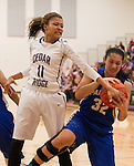 Pflugerville Panther Alyssa Washington grabs the rebound against Cedar Ridge's Imani Robinson Friday at Cedar Ridge.  The Panthers beat the Raiders 70-66.  (LOURDES M SHOAF for Round Rock Leader.)