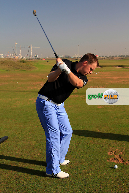 Richie Ramsay (SCO) warms up on the practice range before the start of the Emirates Airlines Invitational Pro-Am 2012  hosted by Abdullah Al Naboodah at Yas Links Golf Course, United Arab Emirates, 30th January 2012 (Photo Eoin Clarke/www.golffile.ie)