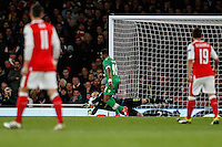 David Ospina of Arsenal saves from Virgil Misidjan of Ludogorets Razgrad (centre) during the UEFA Champions League match between Arsenal and PFC Ludogorets Razgrad at the Emirates Stadium, London, England on 19 October 2016. Photo by David Horn / PRiME Media Images.