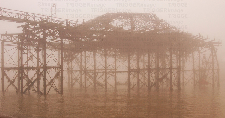 The remains of Brighton Pier England through fog