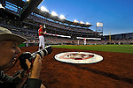 19 May 2012: Washington Nationals outfielder Bryce Harper stands on deck as Sports Illustrated photographer Chuck Solomon prepares to shoot game action of the Baltimore Orioles at Nationals Park in Washington, DC. The Orioles defeated the Nationals 6-5 in the second game of their 3-game series. Mandatory Credit: Ed Wolfstein Photo
