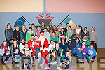 PRESENTS: Santa and his helpers who called to Cumann Iosaef, Caherslee Tralee to give presents to Tralee To-Gether Special Olympic Team on Saturday... ........
