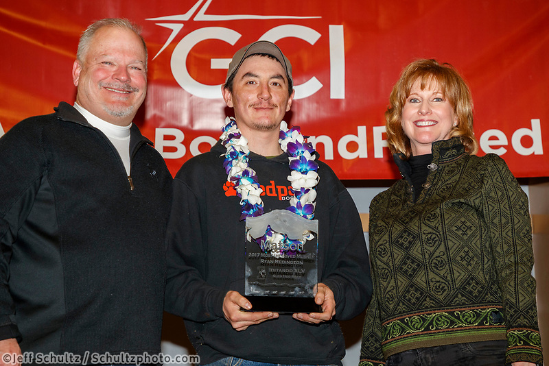 The Matson Most Improved Musher Award is resented by Tamara Grasse, senior account manager for Matson and Don Grasse to Ryan Redington at the Nome Musher's Award Banquet during the 2017 Iditarod on Sunday March 19, 2017.<br /> <br /> Photo by Jeff Schultz/SchultzPhoto.com  (C) 2017  ALL RIGHTS RESERVED