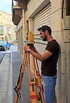 Young male surveyor on street in Rabat Victoria, Gozo, Malta