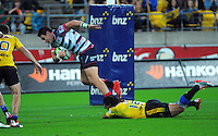 Ma'a Nonu tries to bring down Mike Harris during the Super Rugby match between the Hurricanes and Rebels at Westpac Stadium, Wellington, New Zealand on Friday, 13 March 2015. Photo: Dave Lintott / lintottphoto.co.nz