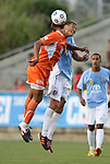 19 May 2012: Carolina's Amir Lowery (in orange) and Puerto Rico's Jarad van Schaik (behind) challenge for a header. The Carolina RailHawks and the Puerto Rico Islanders played to a 1-1 tie at WakeMed Soccer Stadium in Cary, NC in a 2012 North American Soccer League (NASL) regular season game.
