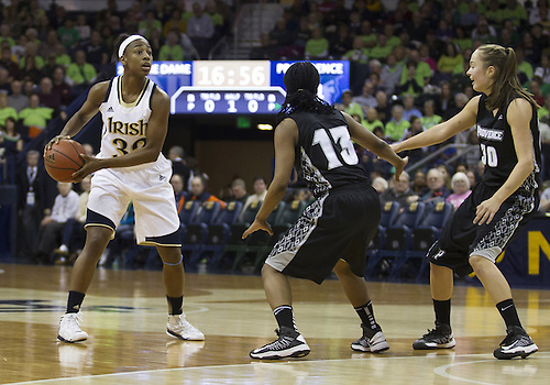 January 26, 2013:  Notre Dame guard Jewell Loyd (32) looks to pass the ball as Providence guard Tori Rule (13) defends during NCAA Basketball game action between the Notre Dame Fighting Irish and the Providence Friars at Purcell Pavilion at the Joyce Center in South Bend, Indiana.  Notre Dame defeated Providence 89-44.