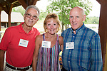 WATERTOWN,  CT-072118JS06--Joel and Paula LeBonte of Watertown with Jim Stinson of Stratford, at a reception for Health Horizons International held at Camp Mataucha in Watertown. Health Horizons International is an NGO dedicated to improving the delivery of primary care in the Dominican Republic. <br /> Jim Shannon Republican American
