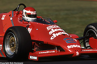 Bobby Rahal drives a March 83C Cosworth in the 1983 IndyCar race at Mid-Ohio Sports Car Course near Lexington, Ohio.