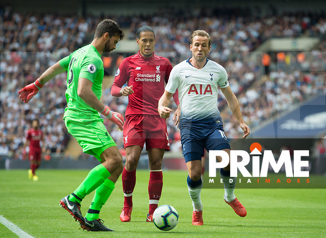 Liverpool's Alisson Becker  and Tottenham's Harry Kane during the Premier League match between Tottenham Hotspur and Liverpool at Wembley Stadium, London, England on 15 September 2018. Photo by Andrew Aleksiejczuk / PRiME Media Images.