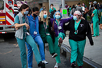 NEW YORK, NY - MAY 7: A group of medical workers perform a dance next to New York Langone Health Hospital as three JetBlue planes pay tribute to healthcare workers with a special low-altitude flight over Manhattan during the pandemic of COVID-19 on May 7. 2020 in New York, NY. COVID-19 has spread to most countries in the world, claiming more than 270,000 lives and more than 3.9 million people have been infected. (Photo by Andres Mesa / VIEWpress via Getty Images)