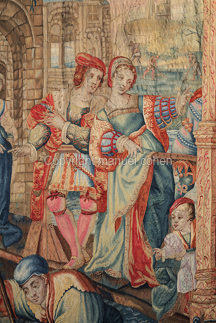 Wealthy couple, detail from the wool tapestry representing Spring, from the series Les Saisons de Lucas, after the artist who is thought to have drawn the original cartoons, Lucas van Leyden, Flemish, 17th century, in the Hotel Lallemant, a mansion built 1495-1518 in French Renaissance style by the Lallemant merchant family, in Bourges, Centre Val de Loire, France. The tapestry shows the agricultural pursuits of the peasants such as gardening and fishing with nets and the leisure pursuits of the nobility in Flanders in the 1530s. After being damaged in WWII, the tapestry was owned by the Nazi Hermann Goering, and was returned to France in 1947 on Liberation, and given to the Bourges museum in 1967. Since 1951 the building has housed the Musee des Arts Decoratifs and it was listed as a historic monument in 1840. Picture by Manuel Cohen