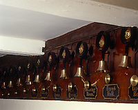 Detail of a row of servants' bells at Erddig, where the original features have been restored to provide a record of the people who lived and worked on the estate