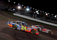Apr 22, 2006; Phoenix, AZ, USA; Nascar Nextel Cup driver Jeff Gordon of the (24) DuPont Chevrolet Monte Carlo passes David Stremme during the Subway Fresh 500 at Phoenix International Raceway. Mandatory Credit: Mark J. Rebilas-US PRESSWIRE Copyright © 2006 Mark J. Rebilas..
