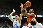 02 February 2013: Virginia Tech's Robert Brown (1) shoots over North Carolina's Jackson Simmons (21) and Marcus Paige (right). The University of North Carolina Tar Heels played the Virginia Tech Hokies at the Dean E. Smith Center in Chapel Hill, North Carolina in an NCAA Division I Men's college basketball game. UNC won the game 72-60 after overtime.