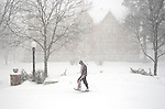 St. Norbert College freshman Matt Kepes, 18, walks past Main Hall on the campus in De Pere, Wis., while wearing snowshoes to navigate the afternoon storm on Feb. 26, 2009.