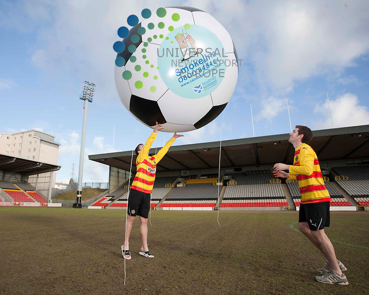 L-R Partick Thistle first team players Bryan Hodge and Ian Flannigan, get behind the national campaign urging scots to kick the smoking habit by calling the smokeline free helpline. .Picture, Johnny Mclauchlan/Universalnews, 27/01/11