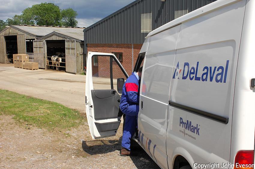 Milking parlour service engineer visiting a farm.