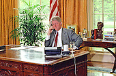 United States President Bill Clinton participates in an Enterprise Zones phone call from the Oval Office of the White House in Washington, DC on Tuesday, May 4, 1993.<br /> The President's Enterprise Zones proposal is designed to attract investment capital into targeted urban areas and to streamline rules, regulations, and paperwork to reward incentive at the local level.<br /> Credit: Ron Sachs / Pool via CNP