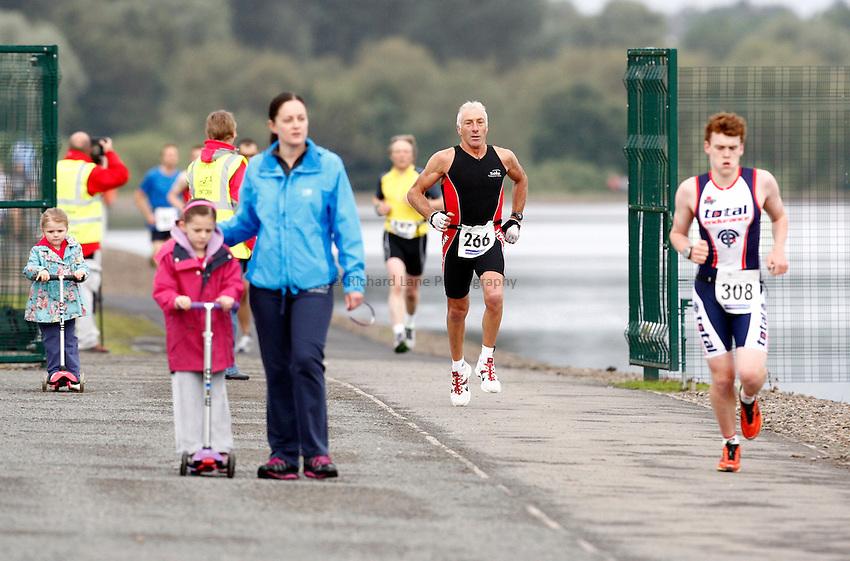 Photo: Richard Lane/Richard Lane Photography. GE Strathclyde Park Triathlon. 02/09/2012. Age Group run.