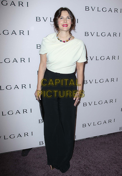 Drew Barrymore.BVLGARI celebrates Elizabeth Taylor's magnificent collection of BVLGARI jewelry held at the BVLGARI store, Beverly Hills, California, USA..February 19th, 2013.full length white top black trousers clutch bag.CAP/ADM/FS.©Faye Sadou/AdMedia/Capital Pictures.