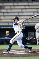 Michigan Wolverines outfielder Matt Ramsey (19) follows through on his swing against the Toledo Rockets on April 20, 2016 at Ray Fisher Stadium in Ann Arbor, Michigan. Michigan defeated Bowling Green 2-1. (Andrew Woolley/Four Seam Images)