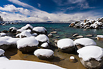 Snowy boulders on the east shore of Lake Tahoe, Nevada.